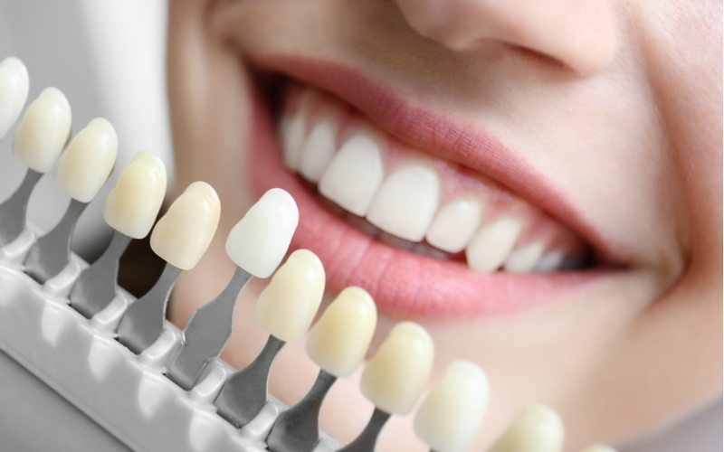 woman smiling while choosing a teeth shade